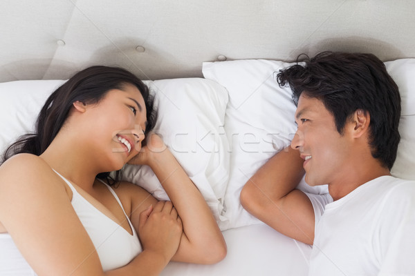 счастливым пару кровать домой спальня Сток-фото © wavebreak_media