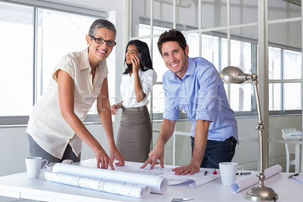 Attractive architects going over plans Stock photo © wavebreak_media
