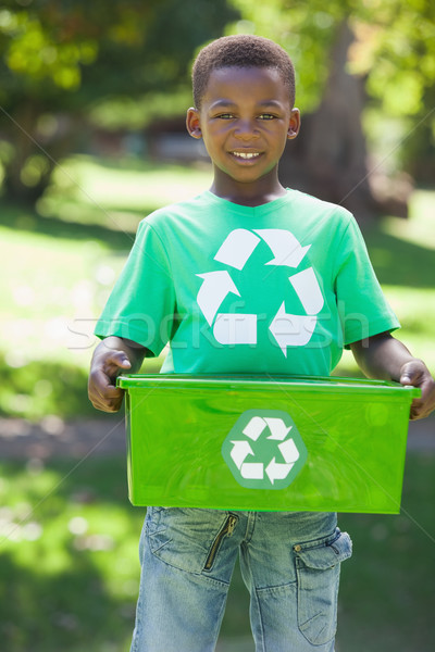 Young boy in recycling tshirt holding box Stock photo © wavebreak_media