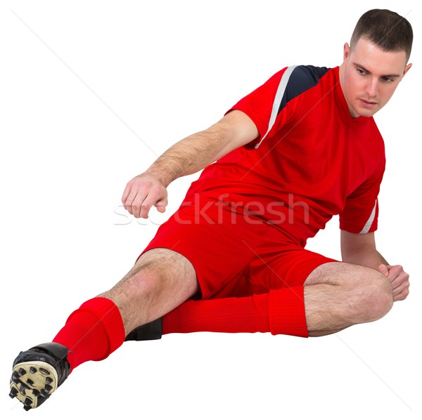 Fit football player playing and kicking Stock photo © wavebreak_media