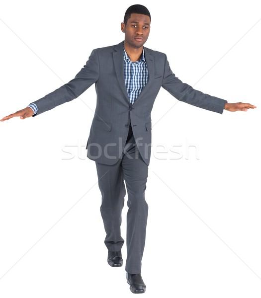 üzletember előad egyensúlyoz tett fehér sétál Stock fotó © wavebreak_media