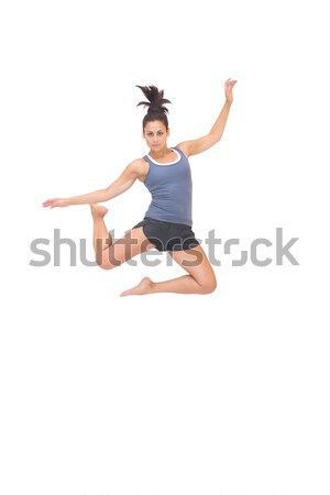 Fit girl in bikini leaping and smiling at camera Stock photo © wavebreak_media