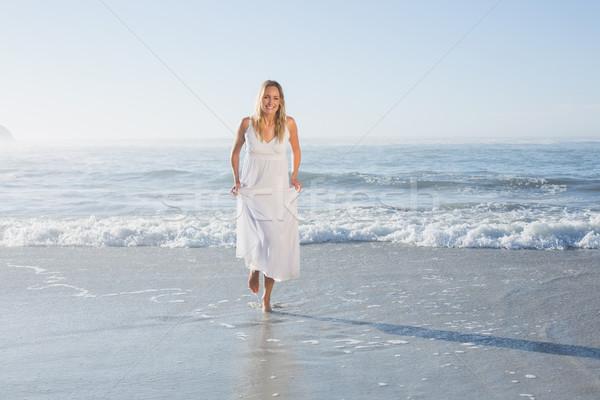 Pretty blonde at the beach in white sundress  Stock photo © wavebreak_media