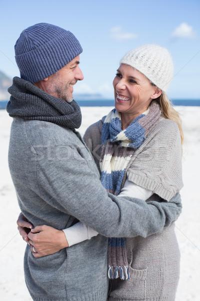 Atractivo Pareja playa ropa de abrigo brillante Foto stock © wavebreak_media