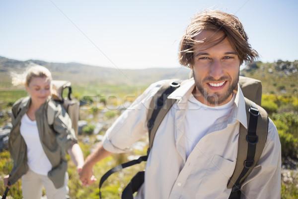 Escursioni Coppia piedi montagna terreno uomo Foto d'archivio © wavebreak_media