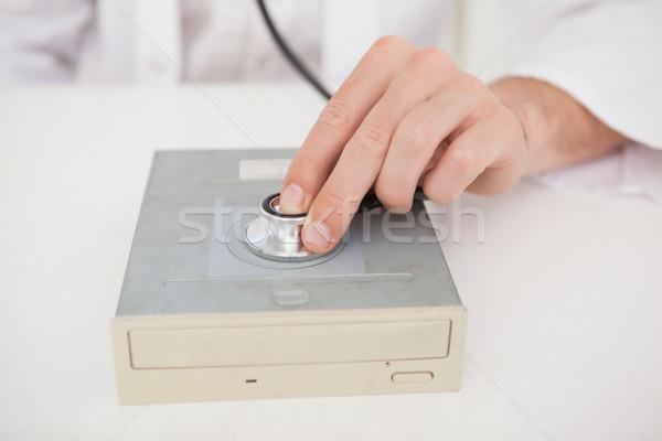 Computer engineer listening to harddrive with stethoscope Stock photo © wavebreak_media