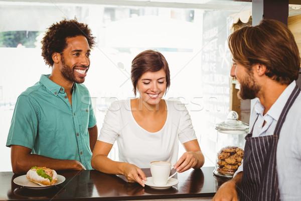 Barista hablar dos clientes Cafetería negocios Foto stock © wavebreak_media