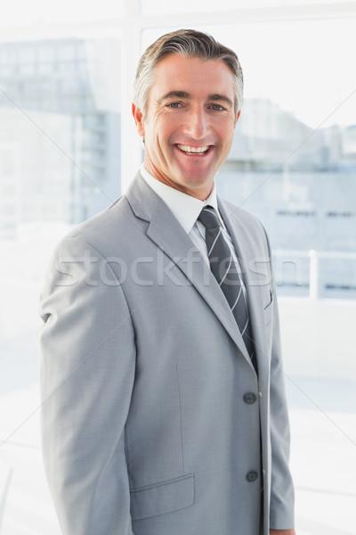 Empresário sorridente câmera negócio escritório sorrir Foto stock © wavebreak_media