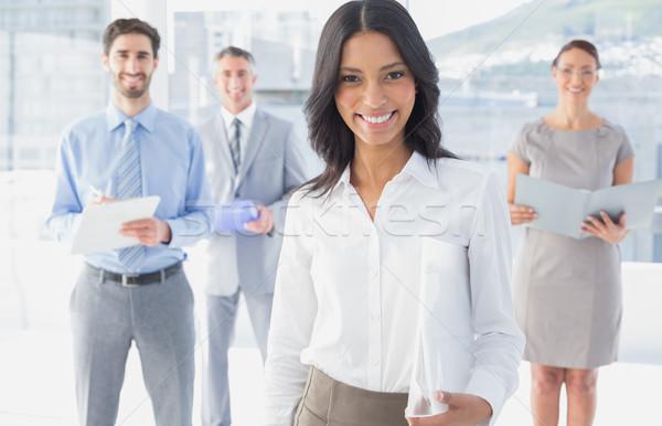 Business woman holding a folder Stock photo © wavebreak_media