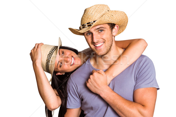 Couple in matching straw hats Stock photo © wavebreak_media