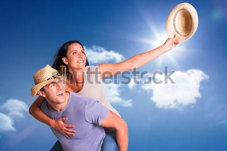 Man giving his pretty girlfriend a piggy back Stock photo © wavebreak_media