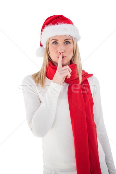 Festive blonde keeping a secret Stock photo © wavebreak_media