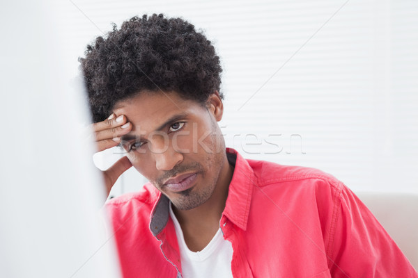 Portrait of an unsmiling businessman thinking Stock photo © wavebreak_media