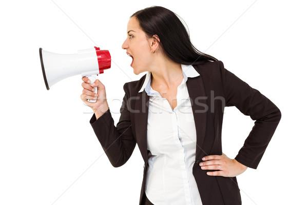 Csinos üzletasszony kiált megafon fehér öltöny Stock fotó © wavebreak_media