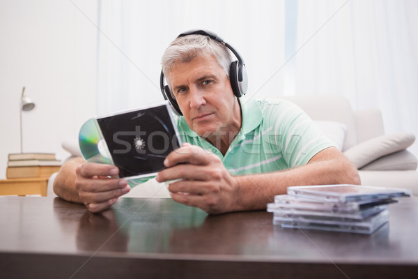 Mature man listening to cds Stock photo © wavebreak_media