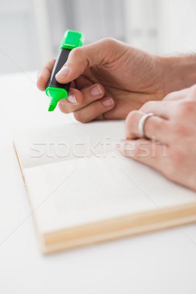 Casual businessman highlighting a book Stock photo © wavebreak_media