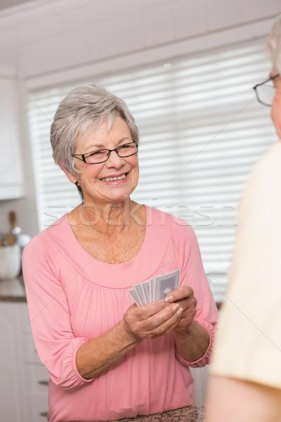 Idős pár kártyapakli pult otthon konyha nő Stock fotó © wavebreak_media