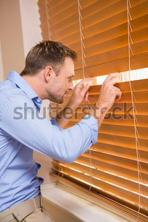 Stock photo: Manual worker cleaning blinds with a towel