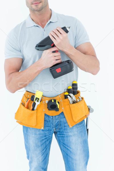 Technician holding handheld drill Stock photo © wavebreak_media