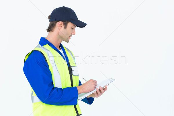 Supervisor escrito notas portapapeles guapo blanco Foto stock © wavebreak_media