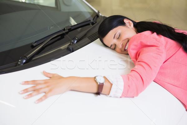 Mosolygó nő ölel fehér autó új autó bemutatóterem Stock fotó © wavebreak_media