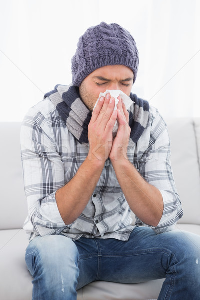 Sick man sneezing  Stock photo © wavebreak_media