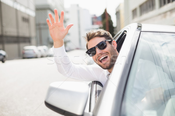 Happy businessman in the drivers seat Stock photo © wavebreak_media