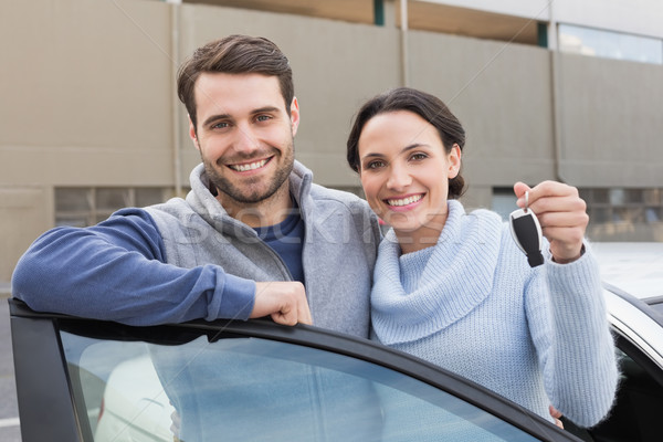 Stock photo: Young couple smiling holding new key