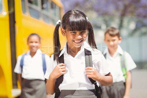 Cute glimlachend camera schoolbus buiten Stockfoto © wavebreak_media