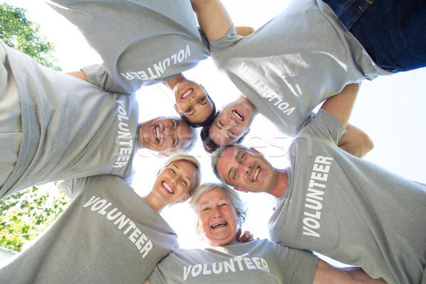 Happy volunteer family looking down at the camera Stock photo © wavebreak_media