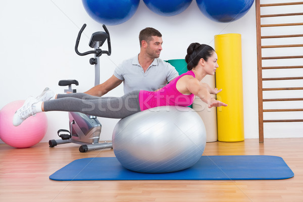 Trainer with woman on exercise ball Stock photo © wavebreak_media