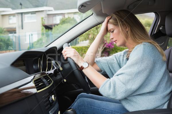 Zmartwiony kobieta posiedzenia siedziba samochodu myślenia Zdjęcia stock © wavebreak_media