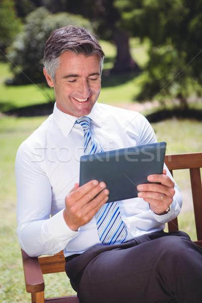 Businessman using tablet in the park Stock photo © wavebreak_media