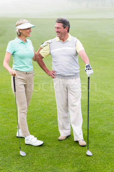 Golf couple souriant brumeux jour Photo stock © wavebreak_media