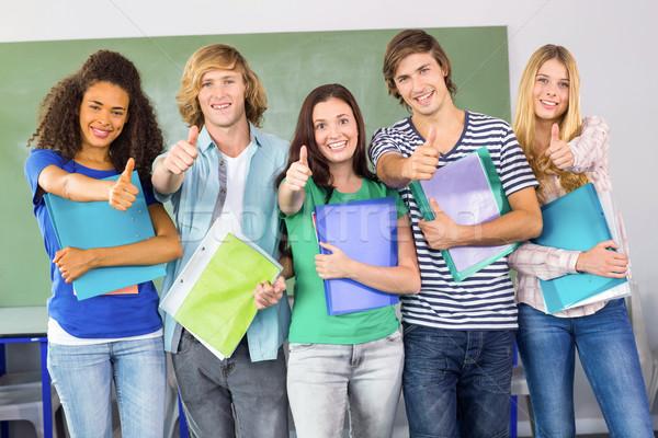 Happy college students gesturing thumbs up Stock photo © wavebreak_media