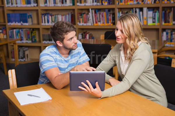 Stock photo: Student getting help from tutor in library