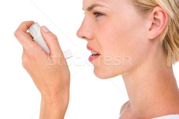 Asthmatic pretty blonde woman using inhaler Stock photo © wavebreak_media