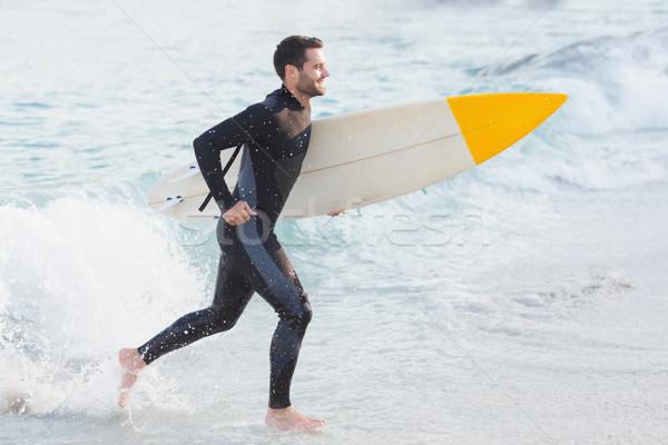 человека доска для серфинга пляж счастливым спорт Сток-фото © wavebreak_media