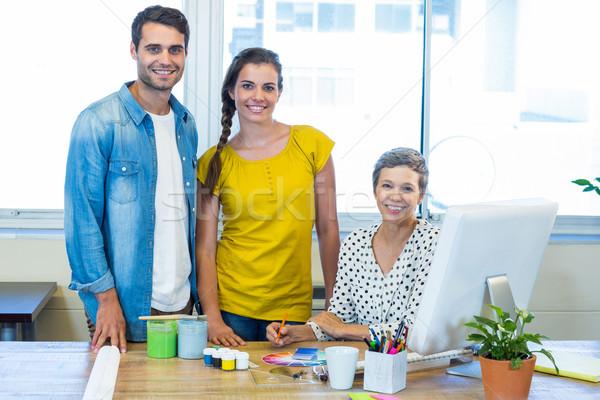 Casual business team smiling at camera during meeting Stock photo © wavebreak_media