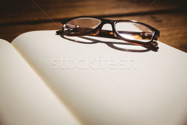 Empty notepad with reading glasses Stock photo © wavebreak_media