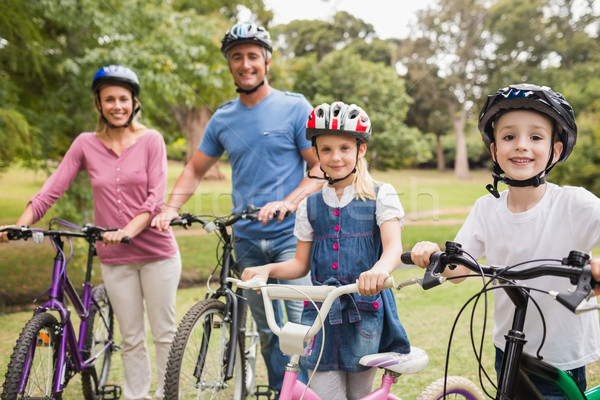 Happy family on their bike at the park  Stock photo © wavebreak_media