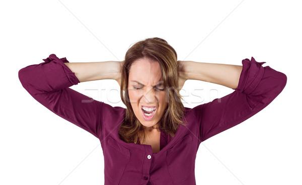 Pretty brunette shouting with hands on head Stock photo © wavebreak_media