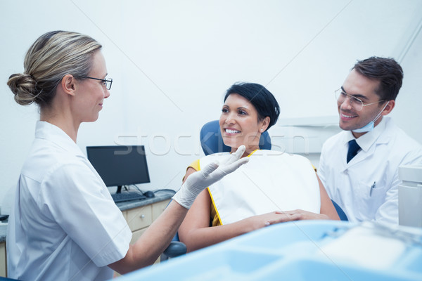 Male dentist and assistant with female patient Stock photo © wavebreak_media