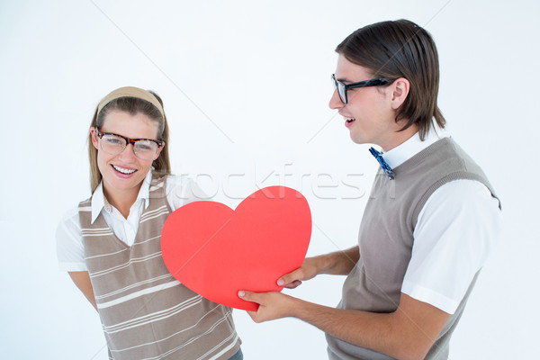 Geeky hipster offering red heart to his girlfriend  Stock photo © wavebreak_media