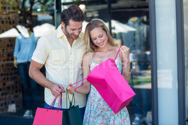 Smiling couple looking into shopping bags Stock photo © wavebreak_media
