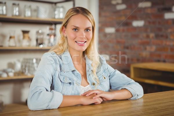 Uśmiechnięty posiedzenia patrząc kamery portret Zdjęcia stock © wavebreak_media