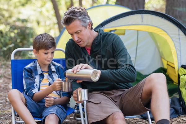 Apa áramló ital csésze fiú erdő Stock fotó © wavebreak_media