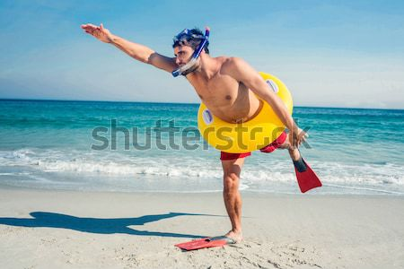 Man with snorkel wearing inflatable ring Stock photo © wavebreak_media