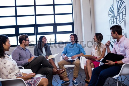 Group of friends interacting with each other Stock photo © wavebreak_media