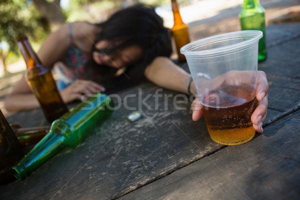 Borracho mujer dormir mesa vidrio Foto stock © wavebreak_media
